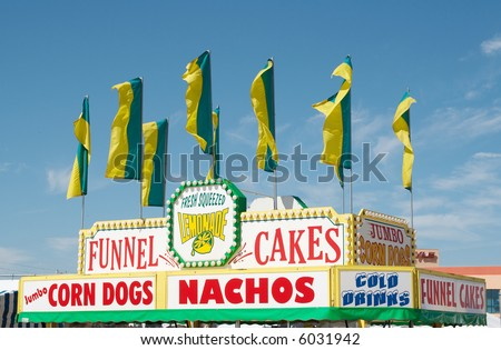 Signs on a food stand at a festival. - stock photo