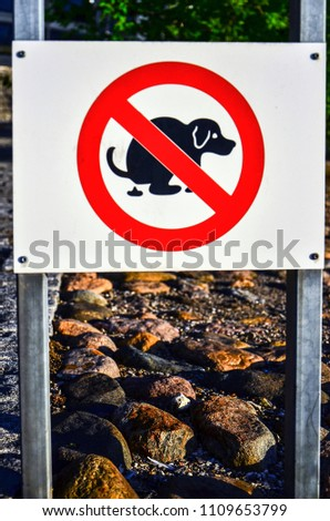 Signs Symbols: Dogs are not allowed to defecate. #1109653799