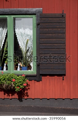 Sigtuna with antique red buildings and decorative windows