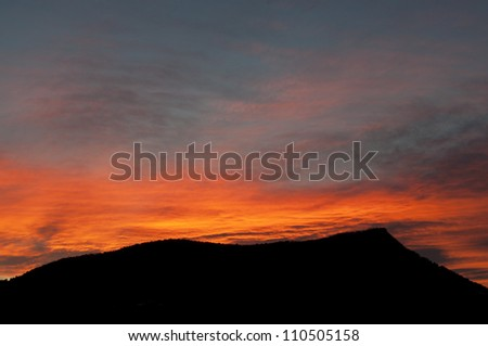 Sihouette of a mountain at sunset