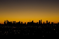 Sihouette of Melbourne city's urban skyline before sunrise in the early morning. VIC Australia