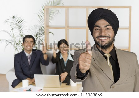 Sikh business executives showing thumbs up sign