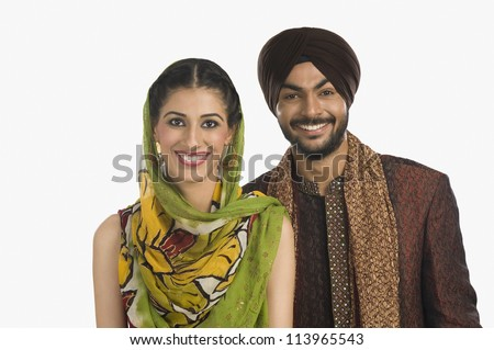 Sikh couple smiling
