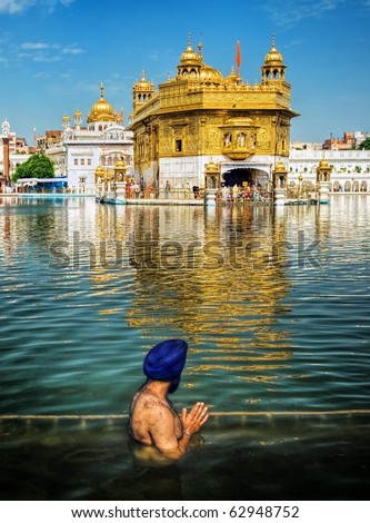 Sikh prayer in pond of Golden Temple, Amritsar, India