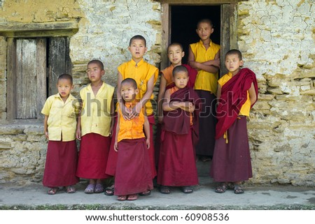 SIKKIM, INDIA - MAY 05: Little monks in front of a house at Sangachoeling Gompa on May 05, 2010 in Sikkim, India. Sangachoeling is a popular monastery in Sikkim.