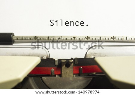 silence message is typed on typewriter, for conceptual background.