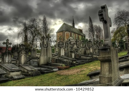 Silent scene at an old cemetery silhouettes of graves. - stock photo