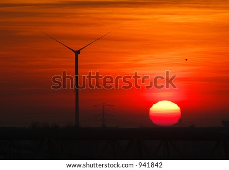 Silent turbine silhouette at sunset.