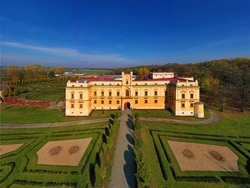 Silesian Rudoltice Castle is a two-storey Baroque building with the entrance tower.