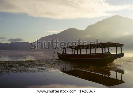 Silhouete of a fisherman boat at Batur Lake, Bali - Indonesia