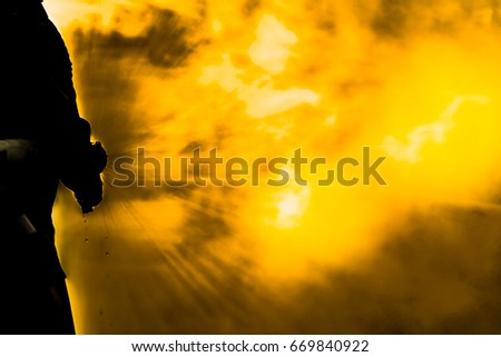 Silhouette a fireman with distinguish fire background.