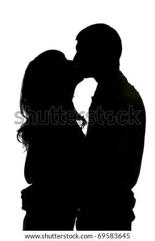 silhouette a happy couple holding and kissing each other