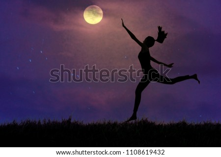 Silhouette, a young woman clutching the moon in open grassland, concept pursues dreams. #1108619432