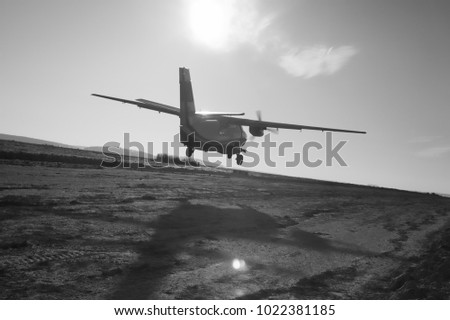 Silhouette Against The Sun Of Take Off Moment Aircraft Black And White