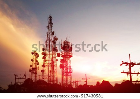 silhouette antennas on sunset time and sky on sunset time background. #517430581