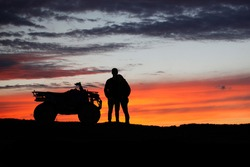 Silhouette ATV or Quad bike in the sunset. Holiday exploration concept with silhouette of quad bike