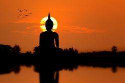 Silhouette Big Buddha statue on sunset