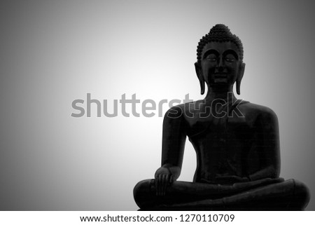 silhouette black buddha on background