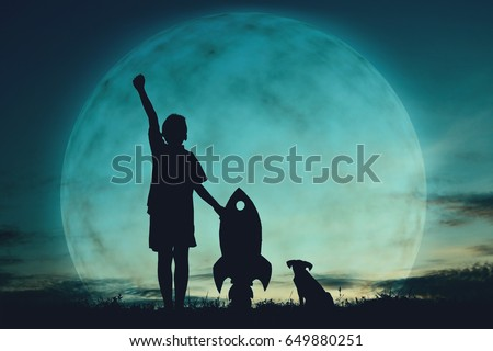 Silhouette boy holding a rocket paper and playing with little dog on the sky and moon background  color of vintage tone #649880251