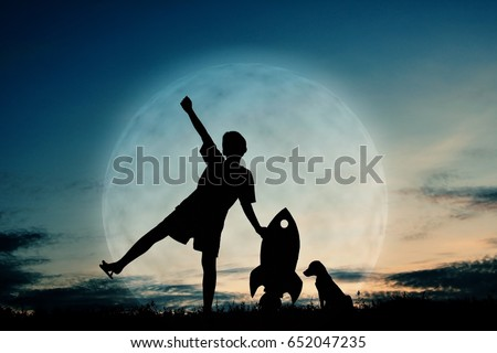 Silhouette boy holding a rocket paper and playing with little dog on the sky with moon background  color of vintage tone #652047235