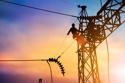 Silhouette Business Industrial Electrician for the installation of electrical systems for alternative energy heavy industry concept over blurred pastel background sunset
