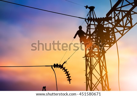 Shutterstock Silhouette Business Industrial Electrician for the installation of electrical systems for alternative energy over blurred pastel background sunset.Heavy industry and Transportation and People concept.