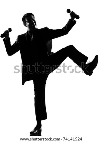 silhouette caucasian business man  expressing winning behavior full length on studio isolated white background