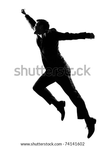 silhouette caucasian business man  expressing winning behavior full length on studio isolated white background