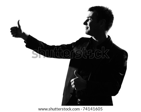 silhouette caucasian business man thumbs up  expressing winning behavior full length on studio isolated white background