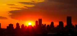 Silhouette City Sunset in Johannesburg South Africa with dramatic red and ornage sky
