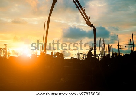 Silhouette construction industry team safely to work load concrete building according to set goal over blurred background sunset pastel for industry background.with Light fair #697875850