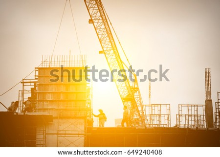 silhouette construction team working on high ground over blurred background sunset pastel for industry background. #649240408