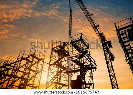 Silhouette construction workers fabricating steel reinforcement bar at the construction site and pouring concrete column industrial  concept background #1016695747