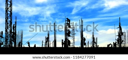 Silhouette construction workers group are working to build reinforcement structure on top of building in construction site with blurred clouds and blue sky background, panorama view  #1184277091