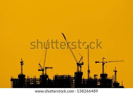 Silhouette crane construction industry and building work.