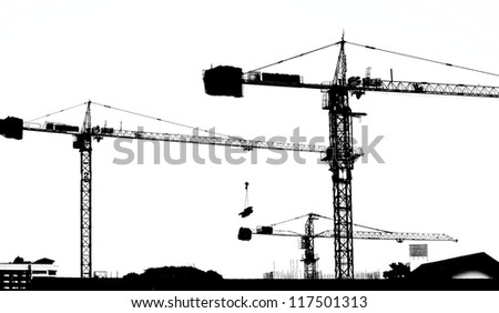 silhouette crane working building