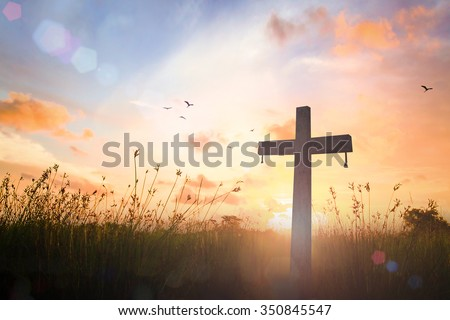 Silhouette cross on blur beautiful autumn sunset with amazing light background. Merry Christmas Card Thankful Adoration Glorify Peace Evangelical Hallelujah Blessing Amen Hope Religion concept