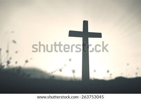silhouette cross on blurred...