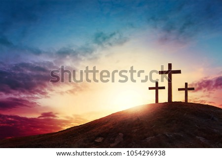 Silhouette cross on Calvary mountain sunset background. Easter concept #1054296938