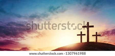 Silhouette cross on Calvary mountain sunset background. Easter concept #1307961988