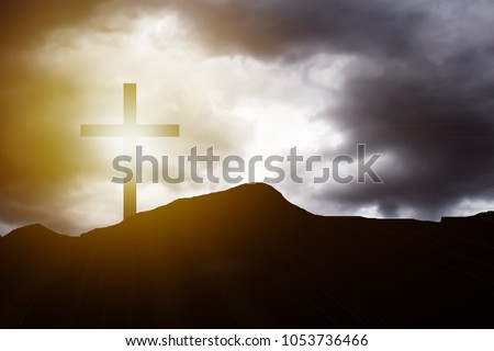 Silhouette cross on mountain sunset background. Abstract for belief break sin aim pain son of god saint Paul, he is risen in sunrise Easter day God calvary concept good friday