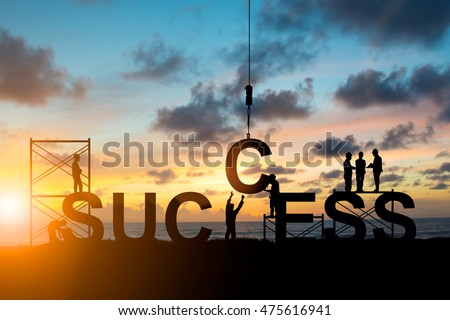 Silhouette employees work as a team to work out successfully over blurred sky at sunset #475616941