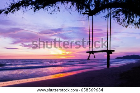 silhouette empty Swing at Sunset Beach