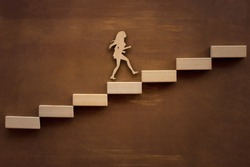 Silhouette enterprising woman climbing the steps of success up