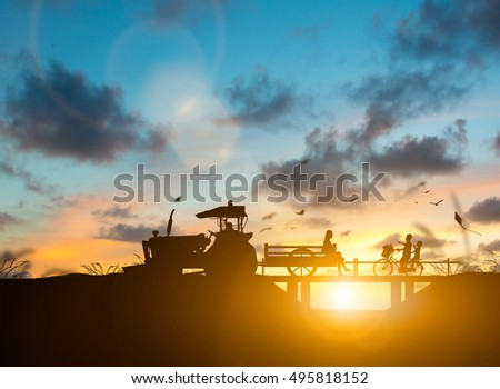 silhouette family of agricultural harvest farming by tractor. children learn outside the classroom with nature. The growth of the agricultural world, Education outside the classroom concept.