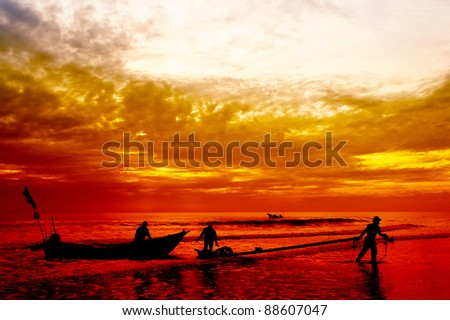 silhouette fisherman at work on great sunset