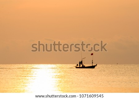silhouette fisherman boat on the sea in morning #1071609545