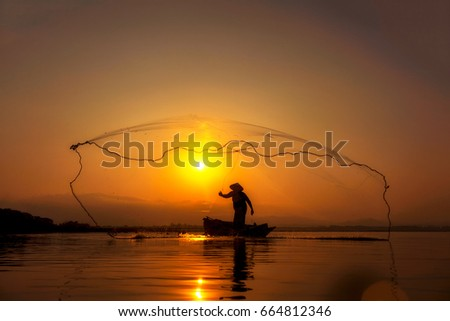 Silhouette fisherman in asia,Job in Asia.fisherman in asia. #664812346