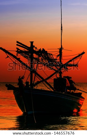 Silhouette Fishing Boat on sunset  a background of  beautiful sunset