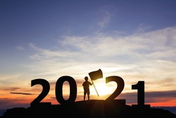 Silhouette freedom little boy standing on peaks with New year 2021. Education concept